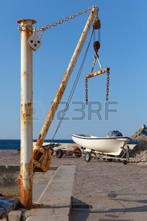 24037830-white-fishing-boat-and-small-crane-in-port-of-petrovac-town-montenegro